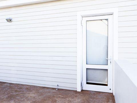 Wood, Property, Real estate, Wall, House, Line, Fixture, Home door, Door, Composite material,