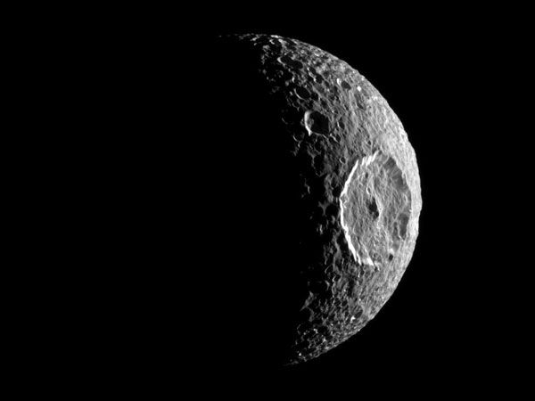 Saturn's Death Star Moon Is Hiding Something