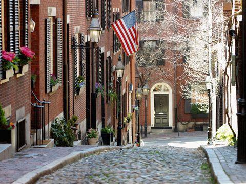 Flag, Plant, Flag of the united states, Flowerpot, Facade, Door, Cobblestone, Flag Day (USA), Sidewalk, Houseplant,