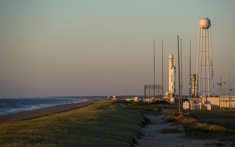 The Orbital Sciences Corporation Antares rocket, with its Cygnus cargo spacecraft aboard, is seen during sunrise on the Mid-Atlantic Regional Spaceport Pad-0A at the NASA Wallops Flight Facility September 17, 2013 in Wallops Island, Virginia.