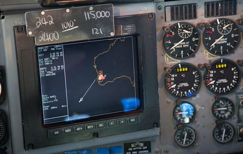 A navigation screen used by pilots aboard a Royal Australian Air Force AP-3C Orion aircraft shows their current location represented by a white circle during their mission to search for missing Malaysian Airlines flight MH370 over the southern Indian Ocean.