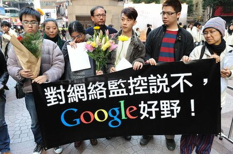 A group of Google users hold a banner to wish Google well in Hong Kong on January 14, 2010.