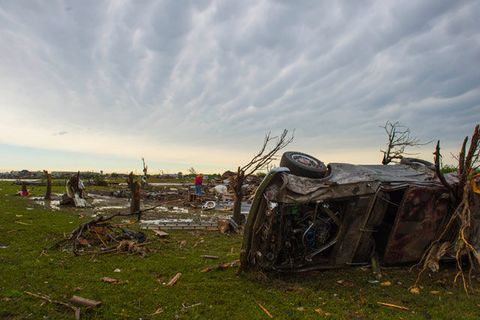 Cheryl Lane, far left, and her mother Patricia Green, collect belongings from the effects of a powerful tornado on May 21, 2013 in Moore, Ok.