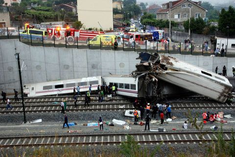 Rescuers work at the site of a train accident near the city of Santiago de Compostela on July 24, 2013.
