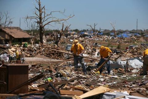 Volunteers sift through the remains of homes damaged by a tornado on June 2, 2013 in Moore, Oklahoma.