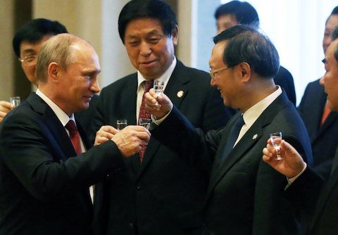 President of Russia Vladimir Putin toasts with vodka along with Chinese delegates during a signing ceremony on May 21, 2014 in Shanghai, China.