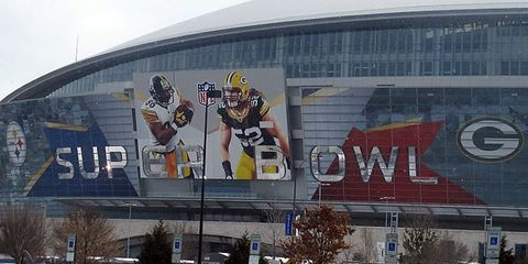 Sport venue, Logo, Commercial building, Stadium, Advertising, Shopping mall, Arena, Billboard,