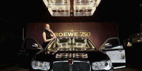 Automotive design, Grille, Automotive lighting, Automotive exterior, Car, Bumper, Personal luxury car, Headlamp, Hood, Luxury vehicle,