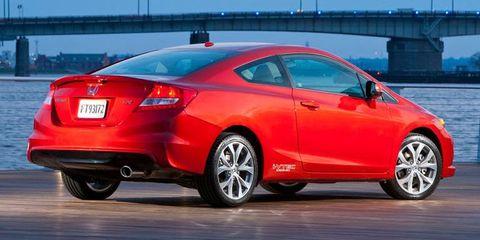 Tire, Wheel, Mode of transport, Automotive design, Vehicle, Automotive tail & brake light, Land vehicle, Car, Red, Bridge,