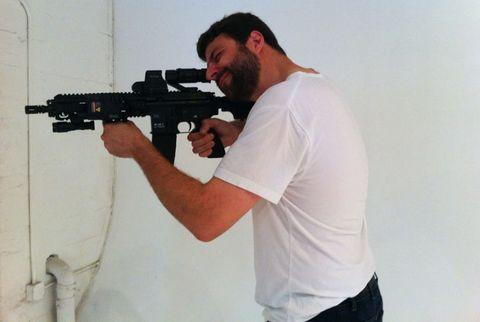 Gun, Human body, Shoulder, Elbow, Shooting, Firearm, Joint, Standing, T-shirt, Trigger,