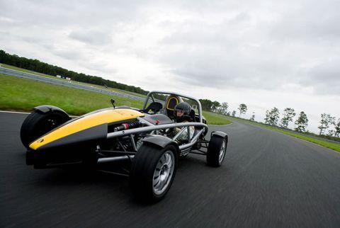 Tire, Automotive tire, Automotive design, Open-wheel car, Vehicle, Road, Automotive wheel system, Asphalt, Motorsport, Rim,