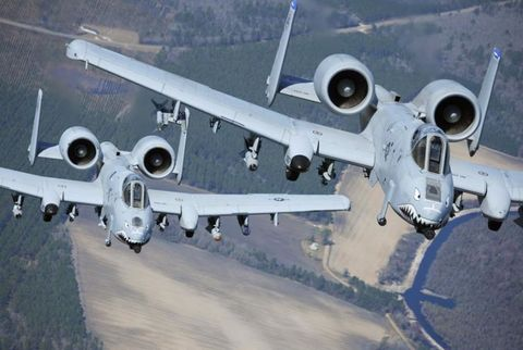 Two A-10C Thunderbolt II aircraft fly in formation during a training exercise at Moody Air Force, Ga.