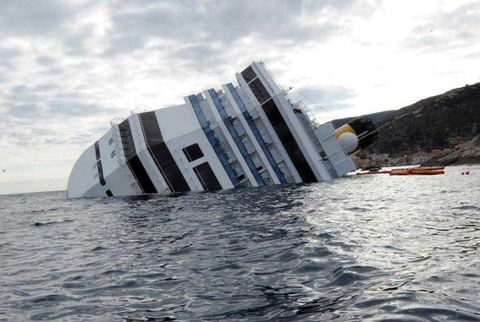 The Costa Concordia, partially submerged after its wreck.