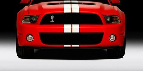 Automotive design, Hood, Headlamp, Automotive lighting, Grille, Automotive exterior, Red, Automotive fog light, Light, Bumper,
