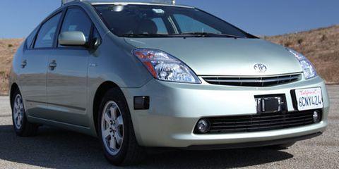 Motor vehicle, Tire, Wheel, Automotive mirror, Mode of transport, Automotive design, Blue, Vehicle, Transport, Glass,