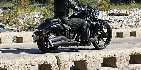 Motorcycle, Tire, Wheel, Automotive tire, Motorcycle helmet, Automotive design, Helmet, Shoe, Fuel tank, Personal protective equipment,
