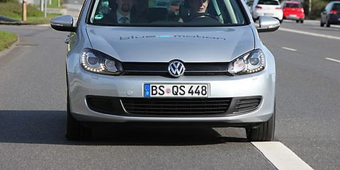 Motor vehicle, Automotive design, Daytime, Vehicle, Land vehicle, Transport, Automotive mirror, Road, Headlamp, Car,