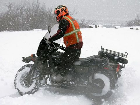 Winter, Automotive tire, Snow, Freezing, Fender, Helmet, Motorcycle, Personal protective equipment, Snowmobile, Ice racing,