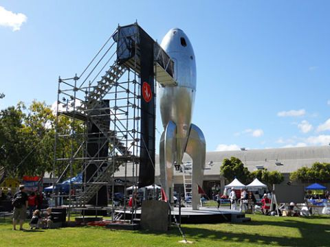 giant metal rocket from back