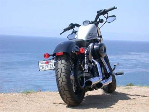 Motorcycle, Tire, Wheel, Motor vehicle, Automotive tire, Automotive design, Fuel tank, Coastal and oceanic landforms, Rim, Landscape,