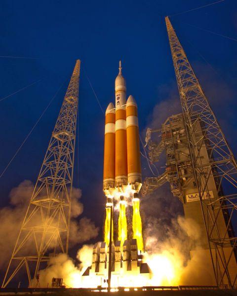 Sky, Atmosphere, Landmark, Amber, Electricity, Space, Tower, Aerospace engineering, Rocket, Spacecraft,