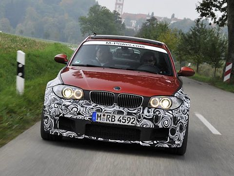 Popular Mechanics drive a prototype 2012 BMW 1-Series M Coupe in Scheyern, Germany. More torque than an M3's V-8 puts the scenery in the rearview mirror.