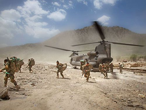 These men are running off of the Chinok helicopter on day one of the mission Afghanistan, south east tip of Paktika Province, Town of Kalay, 10 miles from the Pakistan Border. May, 2009.