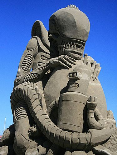 "Carl Jara's ""Alien vs. Bender"" won first prize at the 2010 Windermere Sand Sculpture Classic in Port Angeles, Washington. The theme of the competition was ""Legends of Science Fiction."""