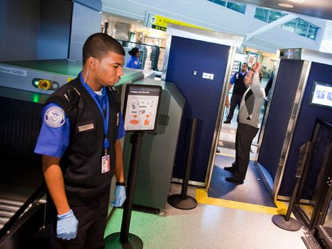 TSA officers give a demonstration of the first Advanced Imaging Technology unit at John F. Kennedy International Airport's Terminal 8 passenger security checkpoint on October 22, 2010 in the Queens borough of New York City.
