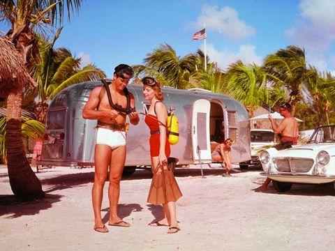 Human body, Classic car, Flag, Arecales, Summer, Shorts, Headlamp, Hood, Vacation, Automotive lighting,