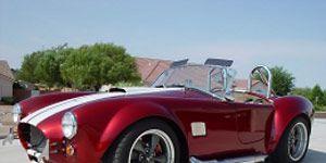 Wheel, Mode of transport, Automotive design, Transport, Vehicle, Automotive lighting, Headlamp, Red, Photograph, Car,