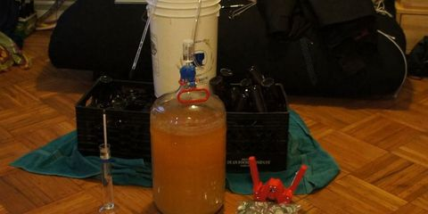 Fluid, Liquid, Bottle, Hardwood, Wood flooring, Perfume, Laminate flooring, Drinkware, Glass bottle, Cylinder,