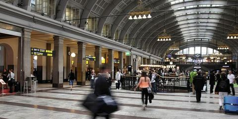 Standing, Urban area, Train station, Travel, Pedestrian, Street fashion, Service, Arcade, Zebra crossing, Baggage,