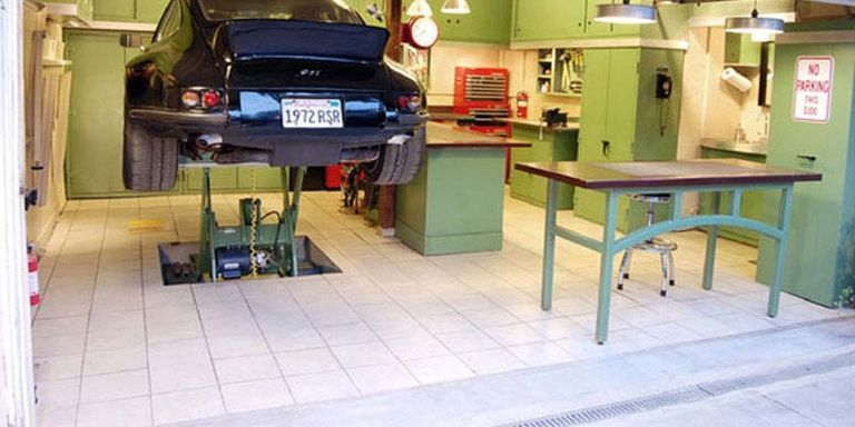 The Most Extreme Man Caves Best Man Caves - Mechanic shop flooring