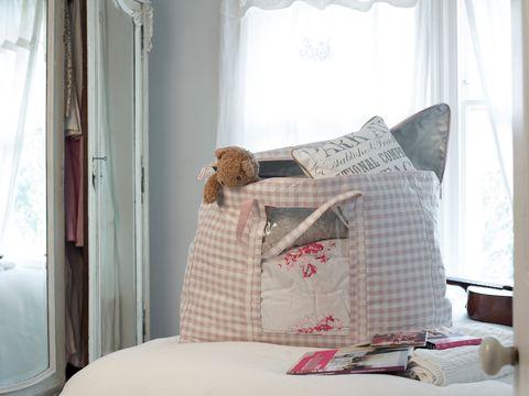 Gingham duvet storage bag on bed