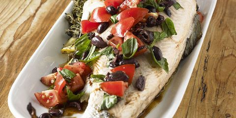 Baked fish with olives and tomatoes