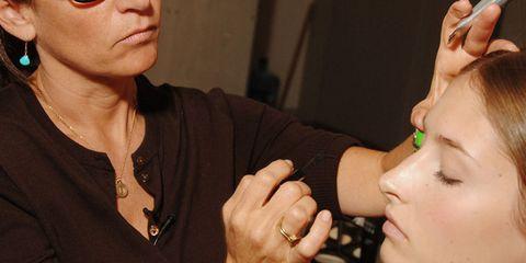 Bobbi Brown applying eye make-up to a model