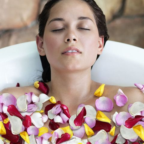 Woman in flower bath