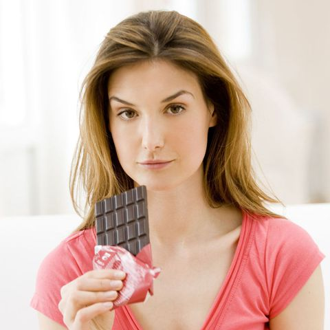 Woman eating a chocolate bar