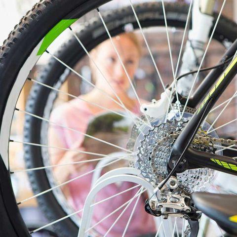 Woman bike shop