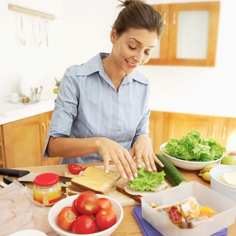 Woman making packed lunch