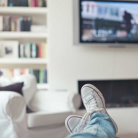 Feet on sofa watching tv