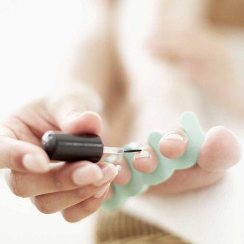 Woman panting toenails