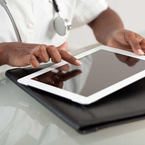 Doctor on digital tablet