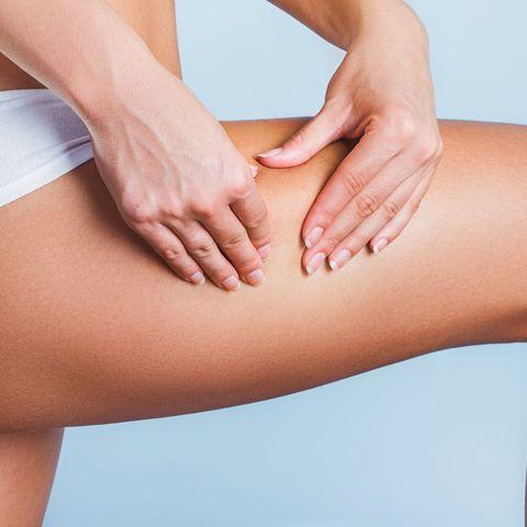 oman pinching leg cellulite