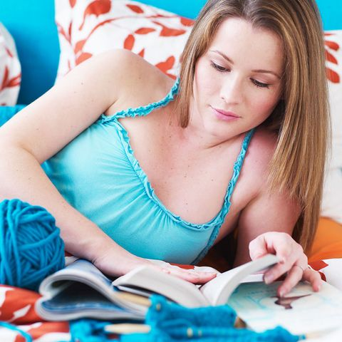 Woman reading with knitting