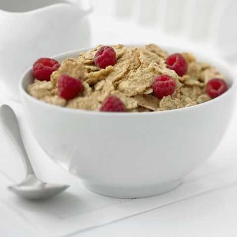 Cereal topped with raspberries