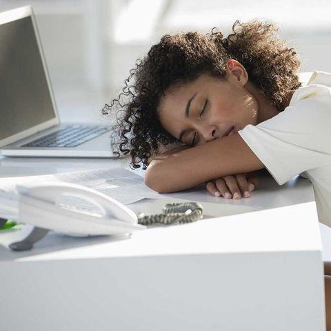 Woman falling asleep at her desk