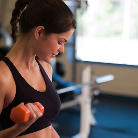 Woman with arm weights