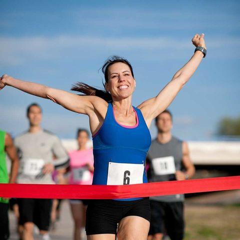 Woman marathon finish line